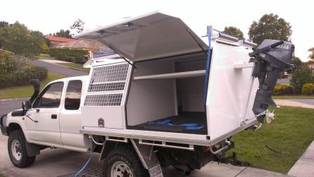 Canopy 2 with separate dog compartment and outboard motor bracket